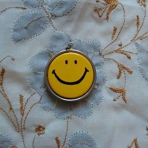 Vintage 1960s 1970s hippie smiley face pendant